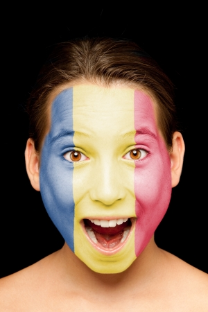 portrait of girl with romanian flag painted on her face photo