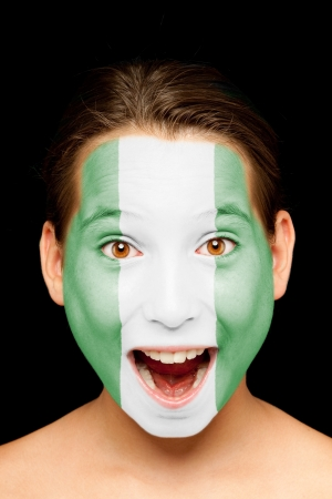 portrait of girl with nigerian flag painted on her face Stock Photo - 17588628