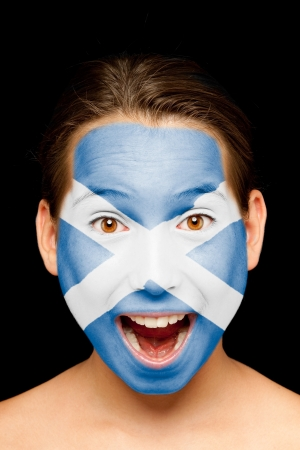 scottish flag: portrait of girl with scottish flag painted on her face Stock Photo
