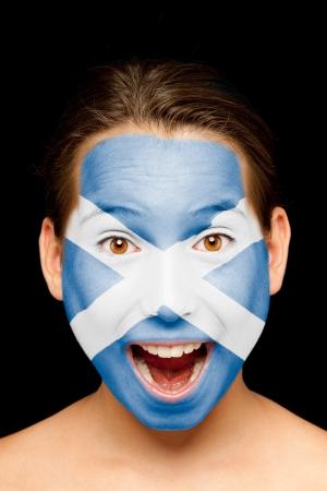 scottish flag: Ritratto di ragazza con bandiera scozzese dipinta sul viso Archivio Fotografico