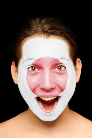 portrait of girl with japanese flag painted on her face Stock Photo - 17588629
