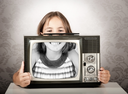 little girl with old retro tv photo
