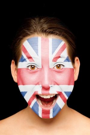 drapeau anglais: portrait de jeune fille avec le drapeau britannique peinte sur son visage