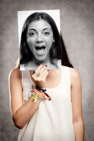 portrait of girl holding a photography of her in front of her face Stock Photo - 17601318
