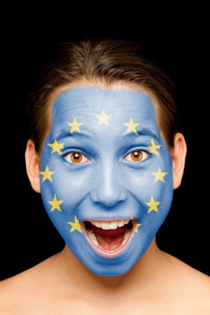 portrait of girl with european flag painted on her face photo