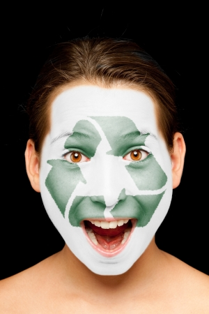 portrait of girl with recycling symbol  painted on her face photo