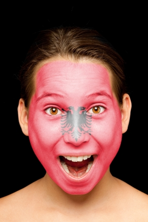 portrait of girl with albanian flag painted on her face Stock Photo - 17601307