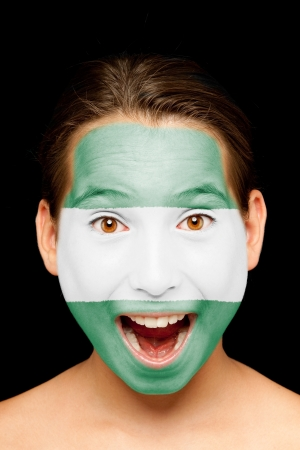 portrait of girl with andalusian flag painted on her face photo