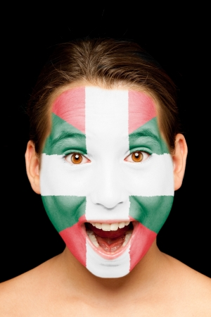 basque woman: portrait of girl with basque flag painted on her face