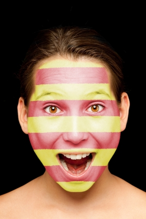 catalonia: portrait of girl with catalan flag painted on her face Stock Photo