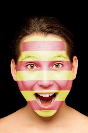 stupor: Retrato de ni�a con el catal�n bandera pintada en la cara