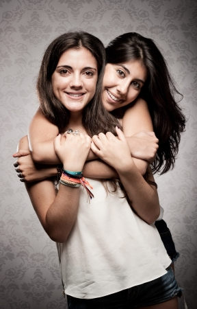 girl embracing her sister photo