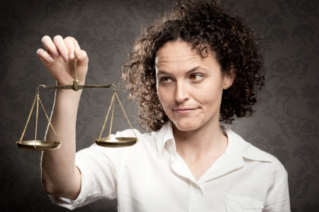 businesswoman holding justice scale photo