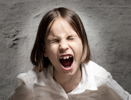 little girl screaming with eyes closed photo