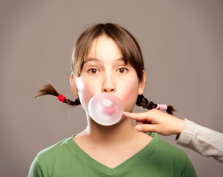 masticate: young girl making a bubble from a chewing gum  Stock Photo