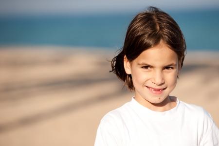 Little girl with the sea in the background Stock Photo - 17606076