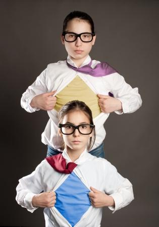 two girls opening her shirt like a superhero Stock Photo - 19238465