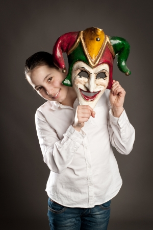 young girl holding carnival mask Stock Photo - 19238459
