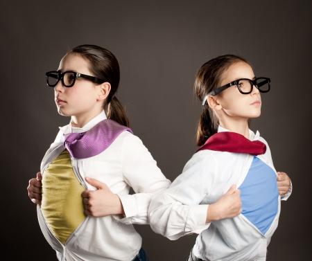 two girls opening her shirt like a superhero Stock Photo - 19238457