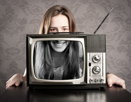young woman with old retro tv photo