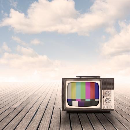 test pattern: retro portable television on pier with sky on sunset Stock Photo