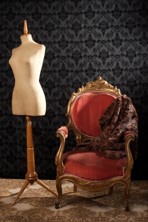 Tailor mannequin and armchair on a vintage background photo