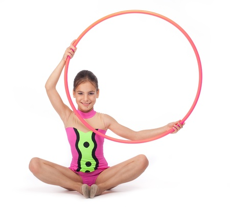 female gymnast: little rhythmic gymnast with hoop