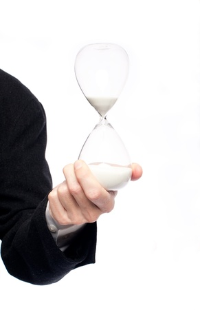 hour hand: businessman hand holding an hourglass on a white background