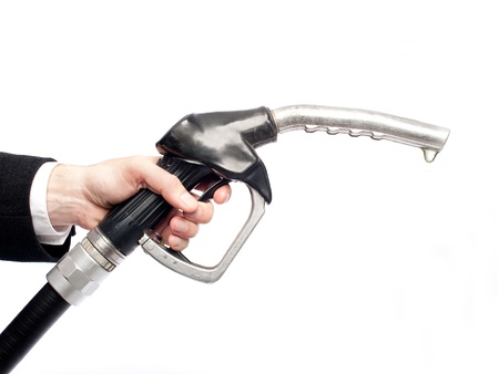 diesel fuel: businessman hand holding a fuel pump