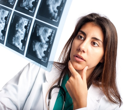 oncologist: Doctor examining a mammogram