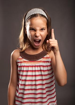 rage: portrait of little girl quarreling