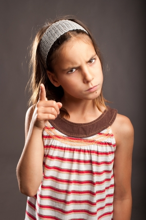 portrait of little girl quarreling photo