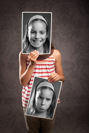 portrait of little girl with two faces Stock Photo - 21626620