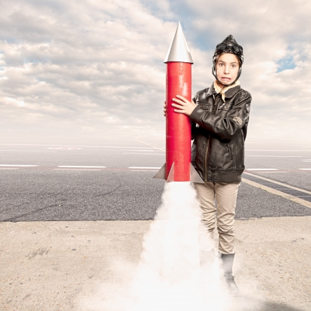 little aviator holding a rocket at the airport Stock Photo