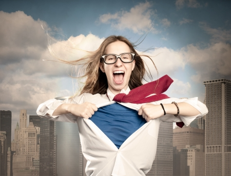 woman chest: woman opening her shirt like a hero Stock Photo