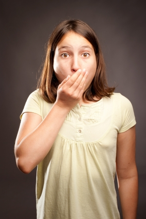 little surprised girl covering mouth with her hand Stock Photo - 22102213