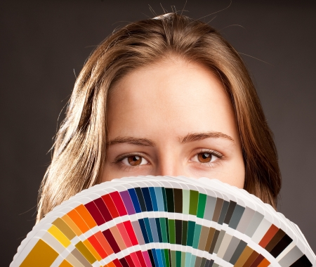 young woman holding a pantone palette photo