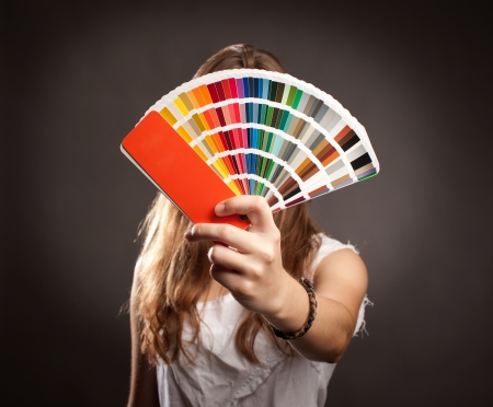 ral: young woman holding a pantone palette
