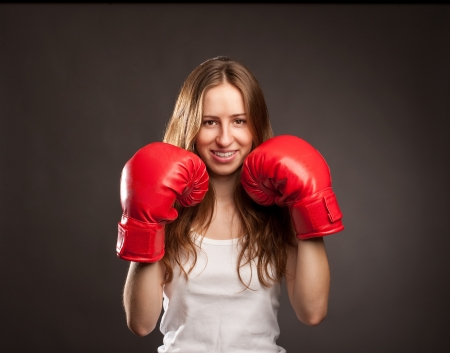 young woman wearing red boxing gloves Stockfoto