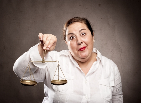 fat woman holding a scale photo