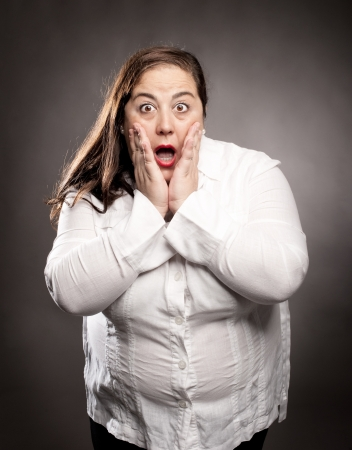 fatten: portrait of woman with surprise expression Stock Photo