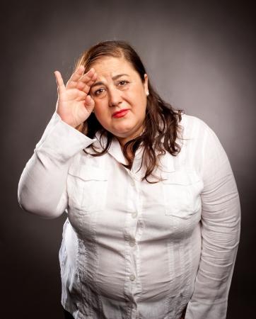 woman with headache holding head photo