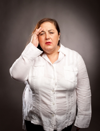 woman with headache holding head photo