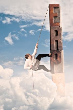 risky business: plump woman climbing on erp word. Enterprise resource planning concept