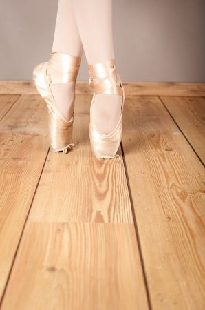 classical ballerinas pointes on wood floor