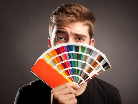 young man holding a pantone palette