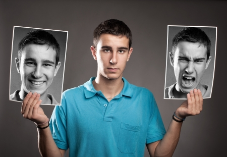 schizophrenia: portrait of young man with two faces