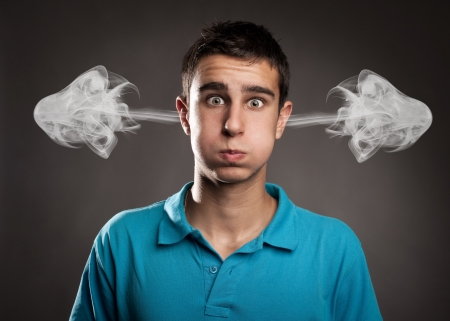 young man with smoke on her ears