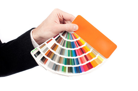 ral: businessman hand holding a pantone palette isoalted on white  Stock Photo