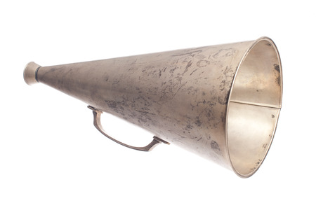 old metallic megaphone isolated on white background